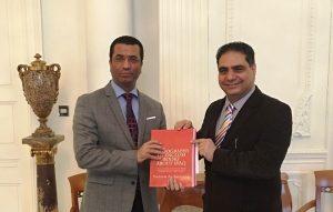 """Iraqi Ambassador to the UK, Dr Saleh Al-Timimi with Nadeem Al-Abdalla, AISC Project Manager and the author of the book pictured, """"Bibliography of English Books about Iraq"""", containing a selected bibliography of over 2,500 books written in English about Iraq in the last two centuries. One of AISC's projects is to expand and update this bibliography, publishing a further edition in time."""
